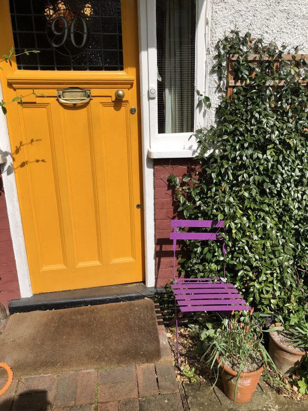 cottage garden seating outside the front door of a London house
